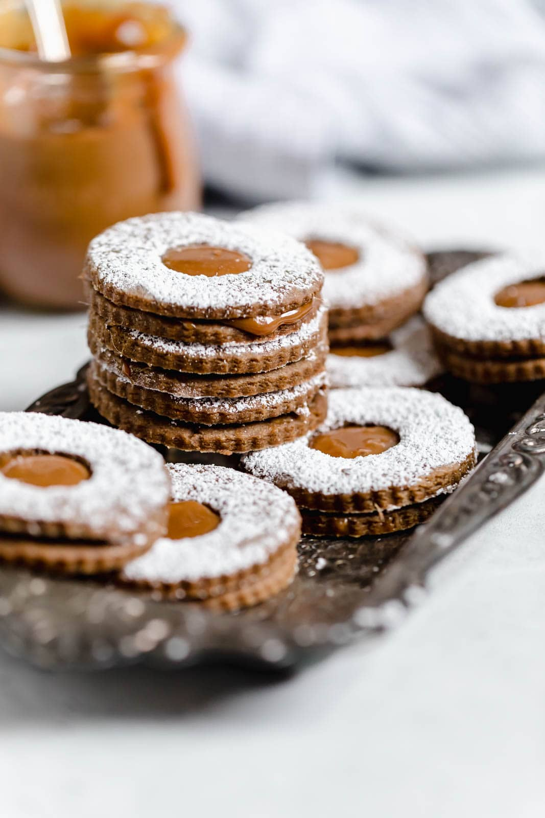 Santa, meet your new favorite cookie. Seriously obsessed with these Gingerbread Linzer Cookies with dulce de leche centers.