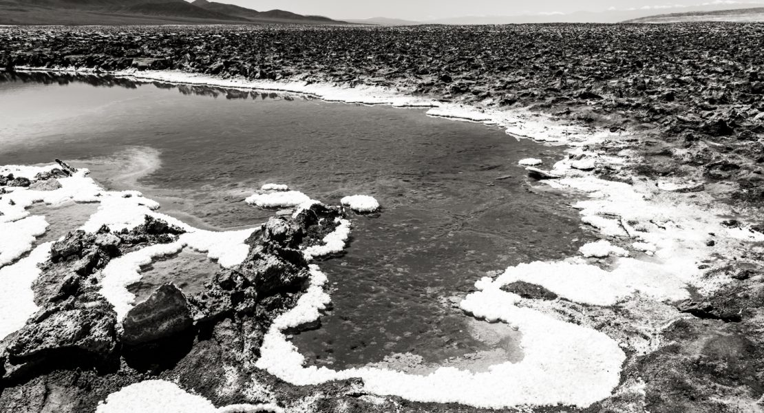 Pool of water at Laguna Baltinache in black and white