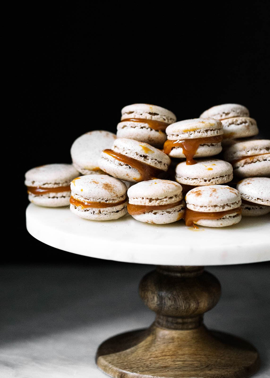 salted caramel macarons on a cake stand