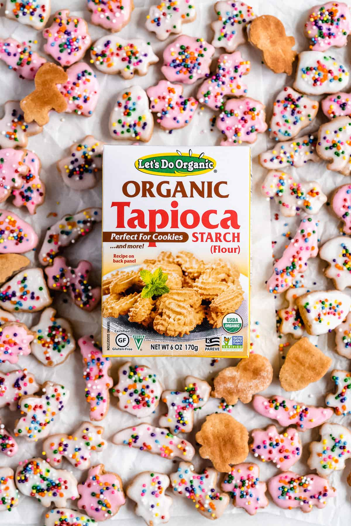 Image of tapioca box on a white surface with animal cracker scattered on the ground.