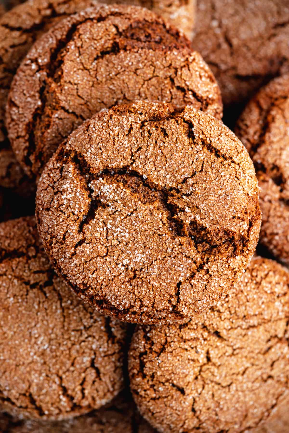 Closeup photo of a plate of Soft and Chewy Ginger Snap Cookies that highlights the texture and inside of each cookie.