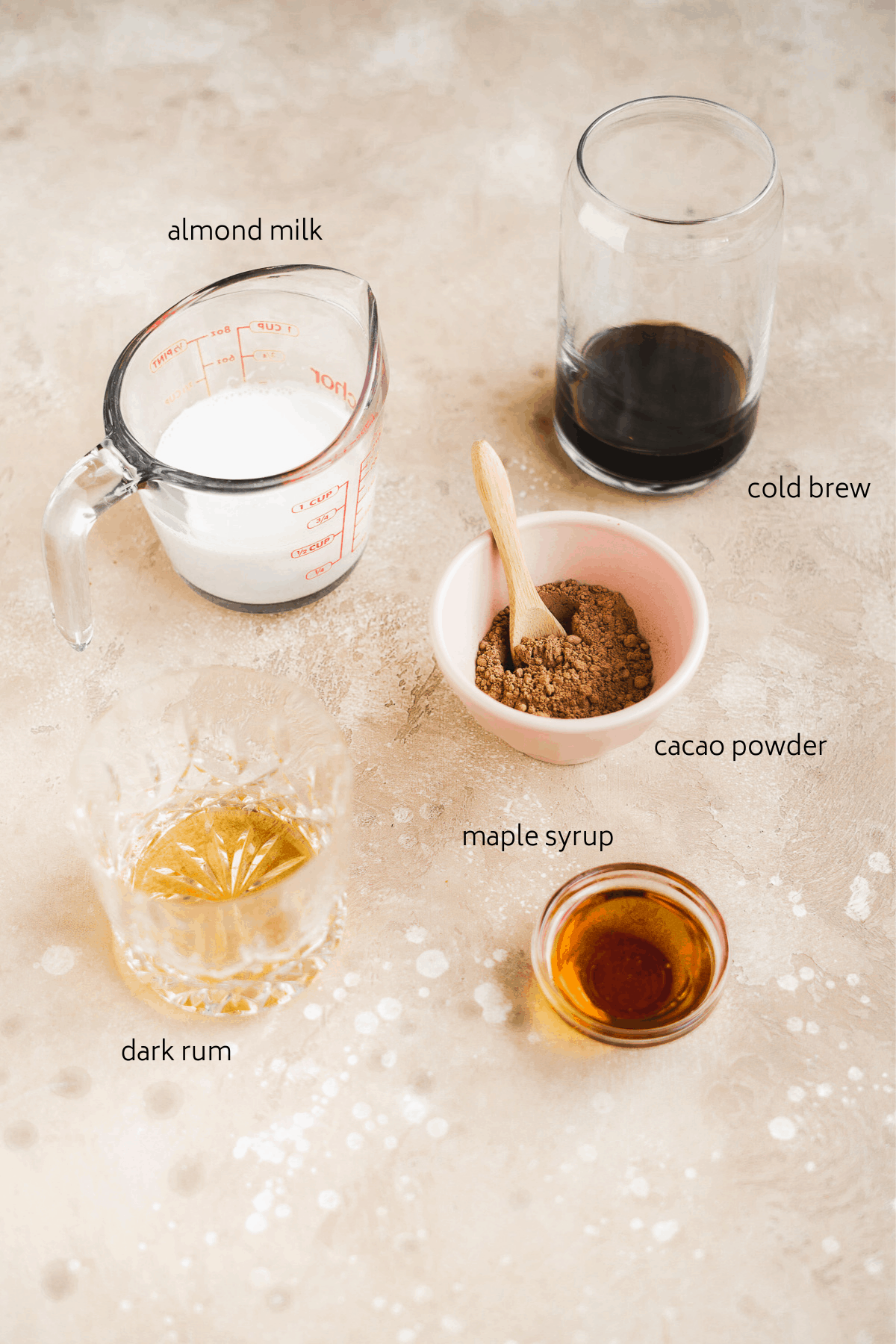 Image of ingredients on a tan surface with labels.