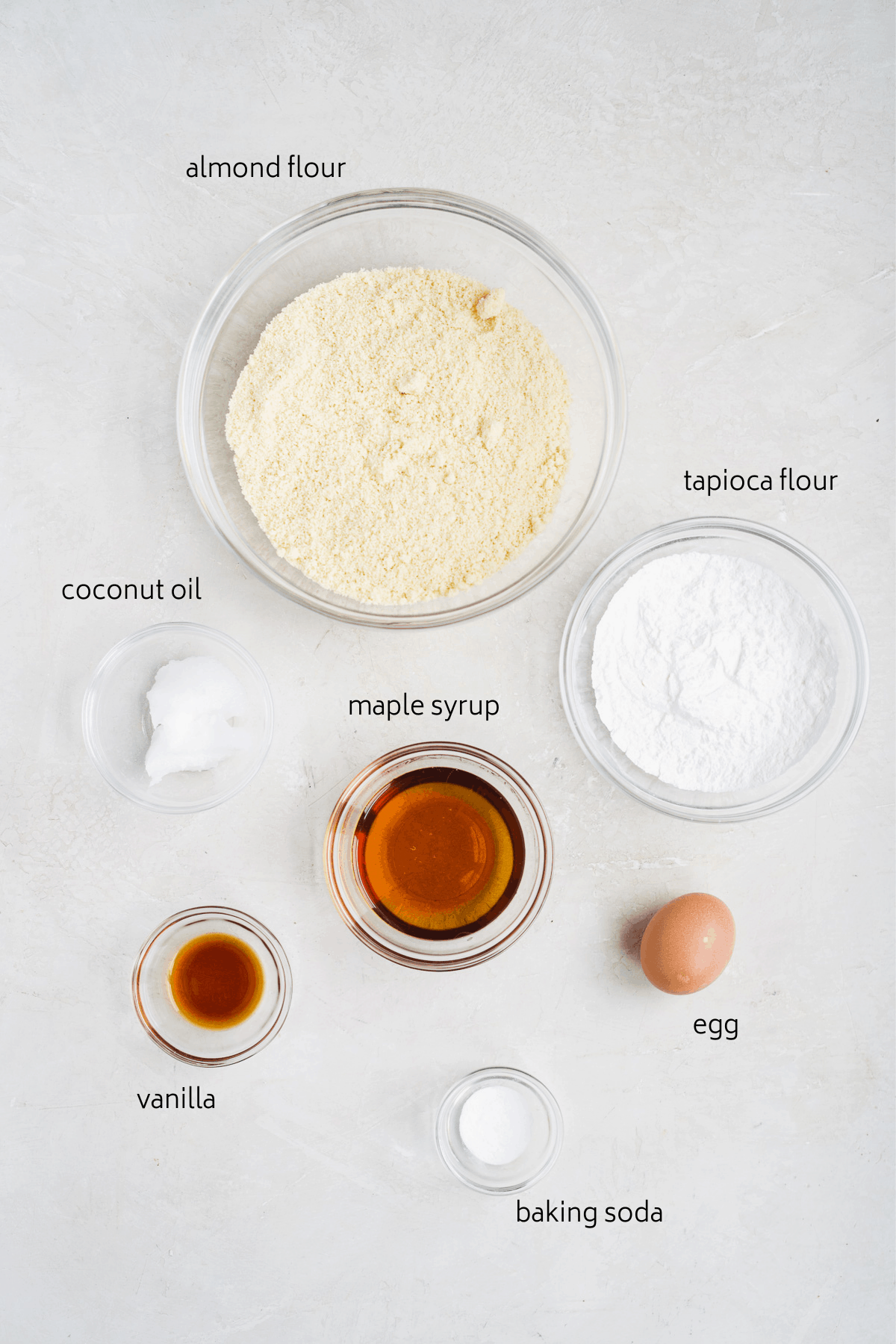 Image of ingredients laid out in glass bowls with labels.