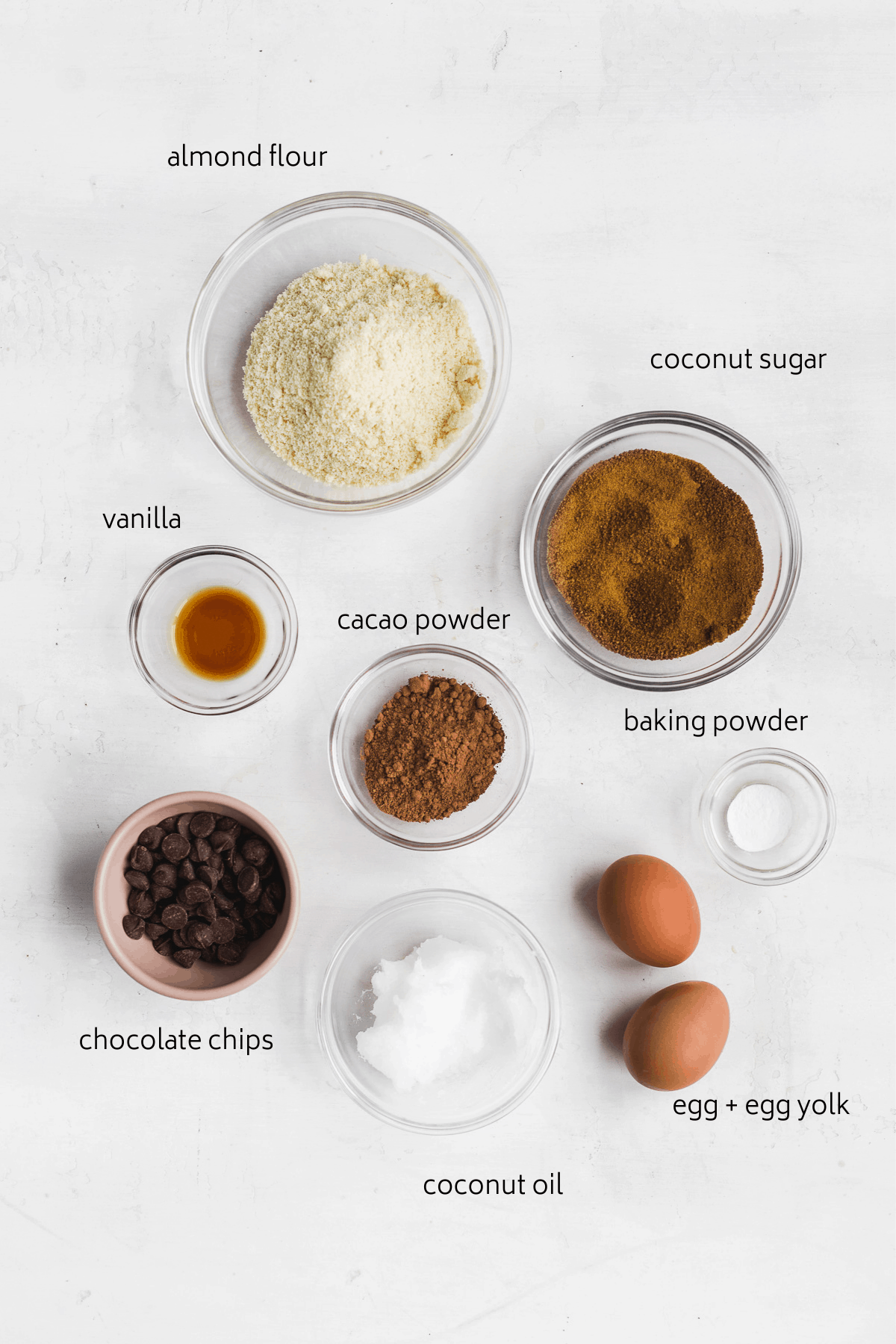 Image of ingredients in bowls on a white surface.