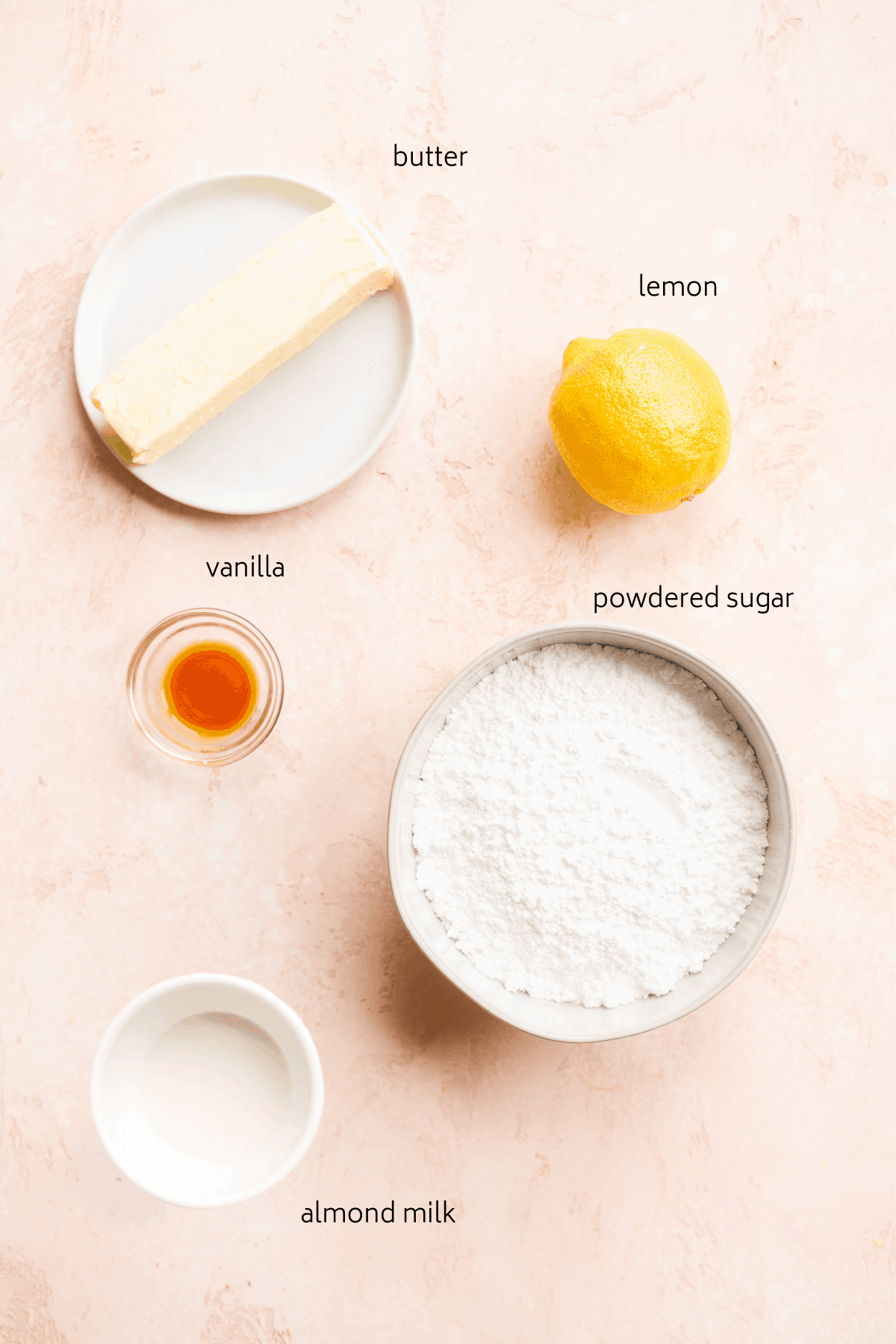 Icing ingredients labeled in black on a white surface.
