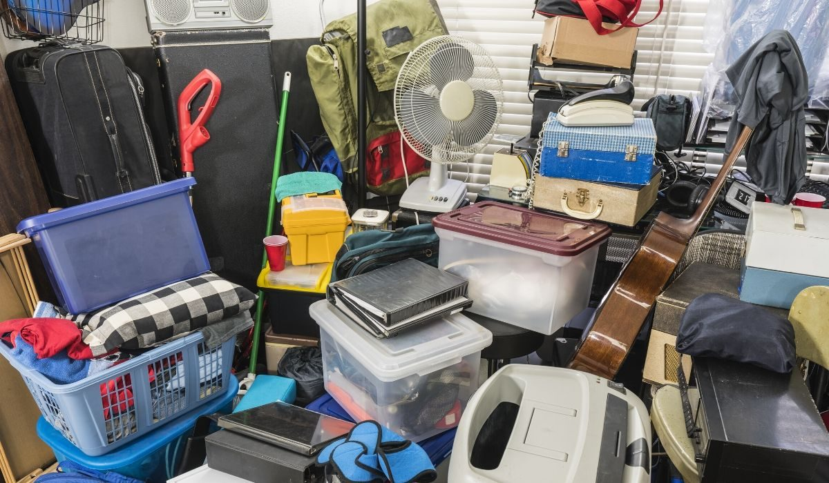 decluttering tips for hoarders-piles of unused stuff thrown in a room