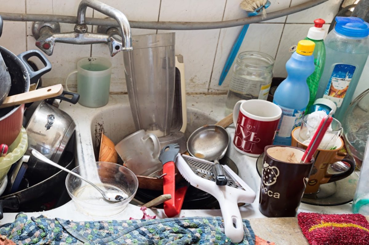 decluttering tips for hoarders-piles of dirty dishes in a dirty sink