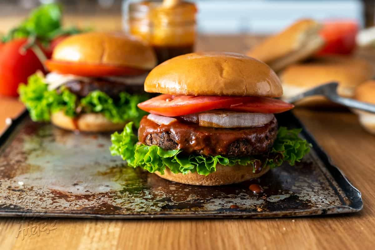 We're still in the heart of grilling season, and what better way to whet that appetite than with a Down Home BBQ Burger from the Vegan Burgers and Burritos Cookbook, by Sophia DeSantis? #vegan #bbq #burgers #vdbburgersandburritoscookbook