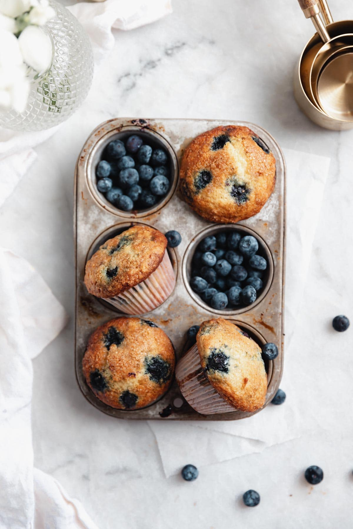 blueberry muffins in a muffin tin