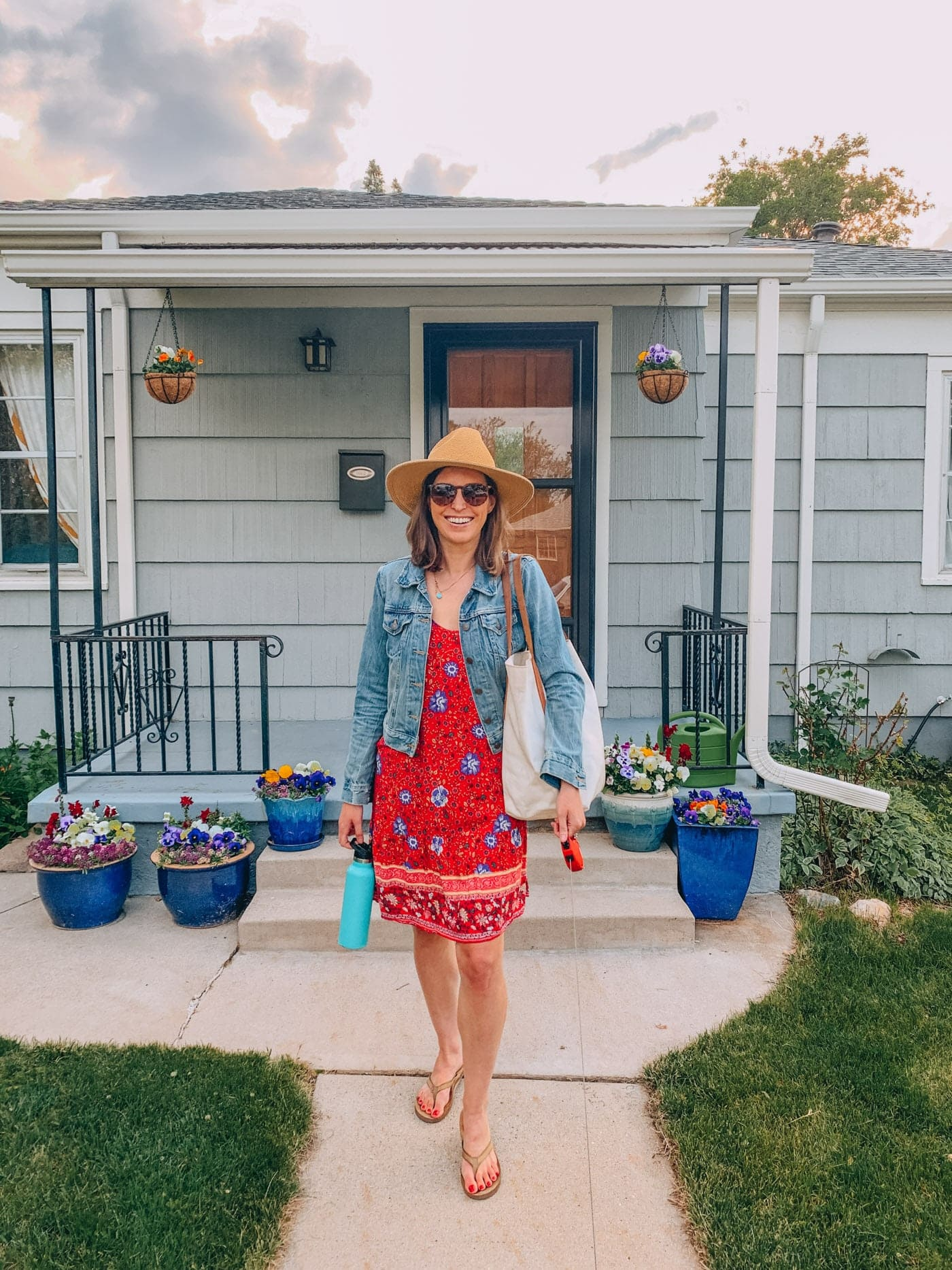 Wearing a Red floral sundress with jean jacket and wide brim hat