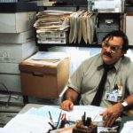 milton-at-desk-in-basement-office-space