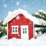 cute little red house covered in snow