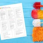 flatlay printable deep cleaning checklist with cleaning tools