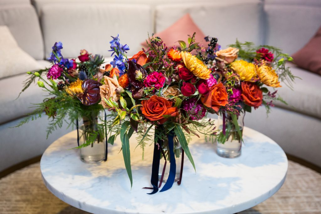 Three flower bouquets on a table
