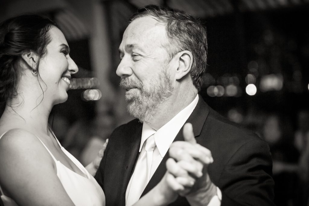 Black and white photo of bride dancing with father at a Water Club wedding