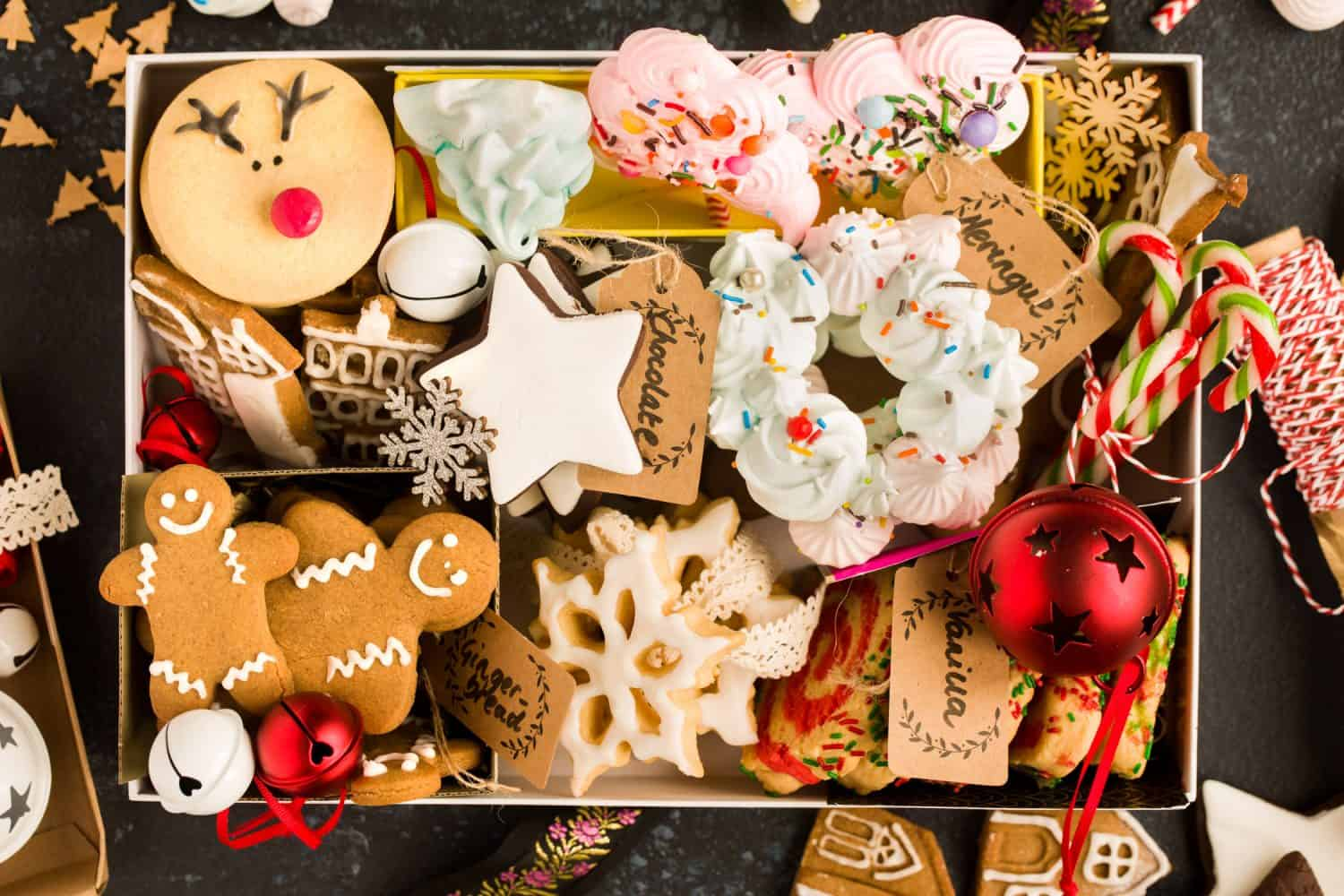 Close up of a gift box containing a selection of biscuits and cookies.
