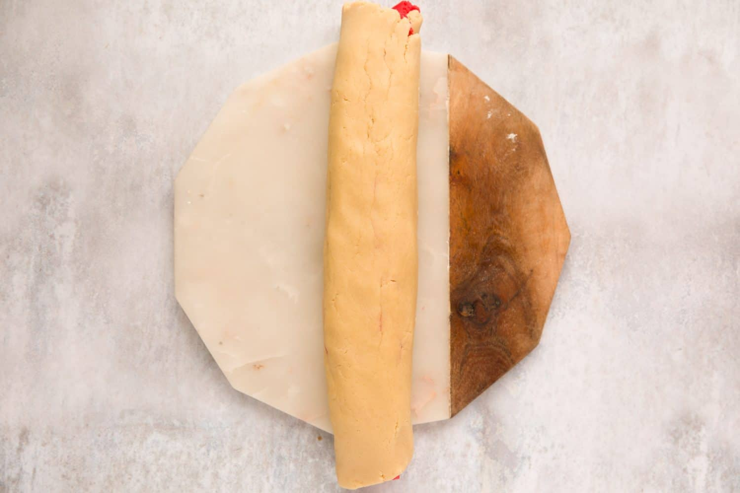 Biscuit dough that has been rolled into a sausage shape.
