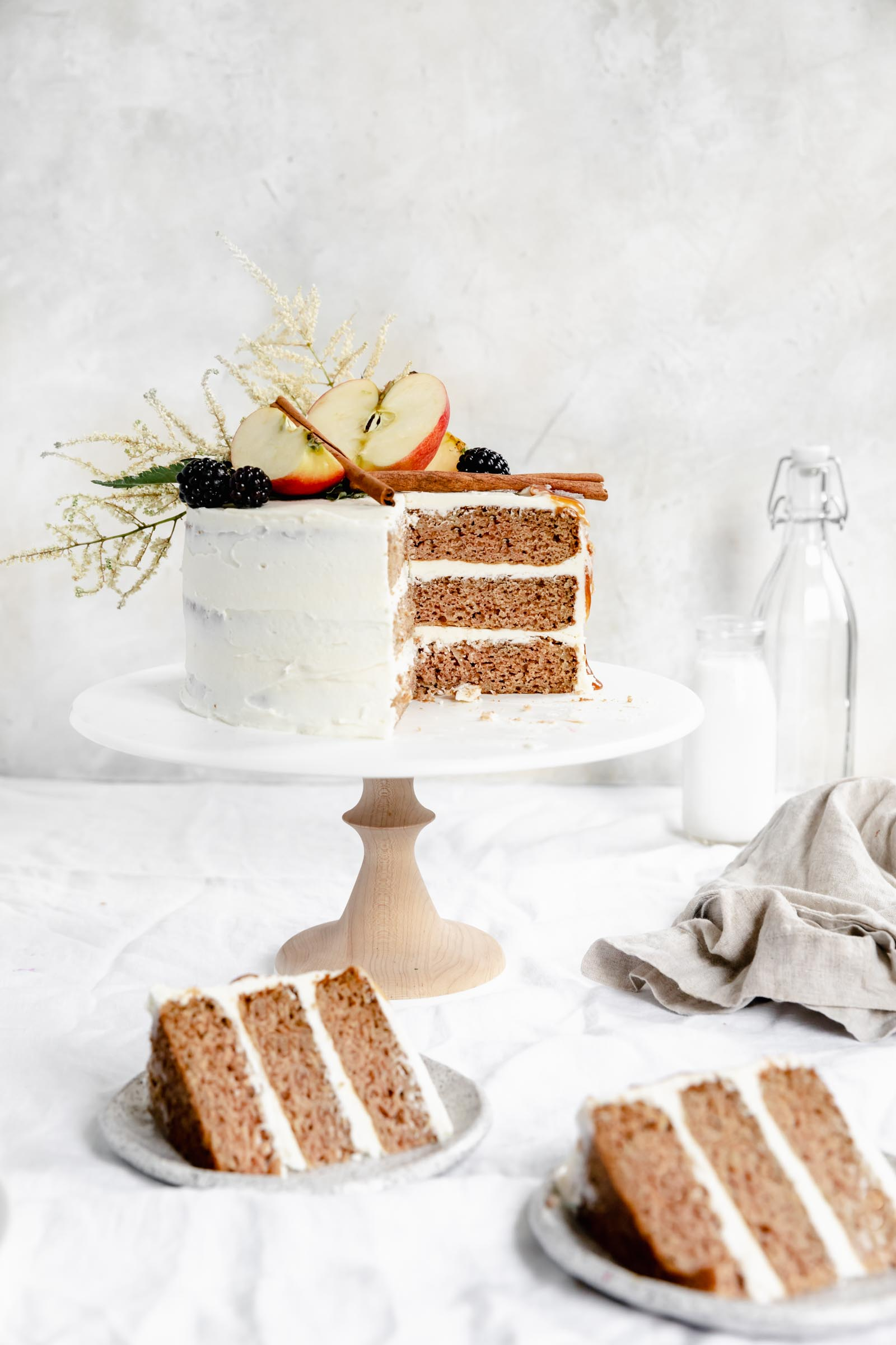 caramel apple cake with two slices on plates