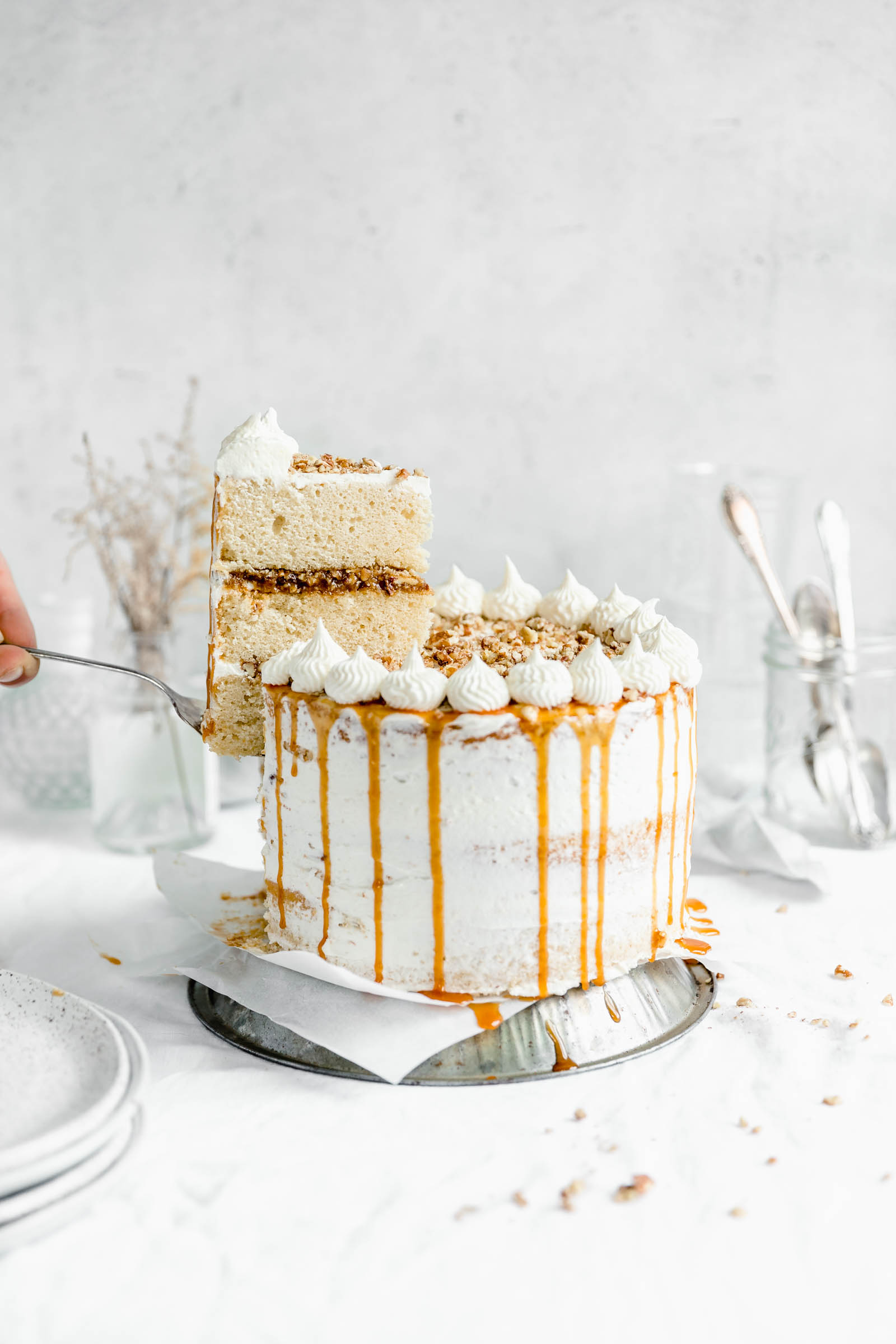 Praline layer with a slice of cake being lifted out. Get it this Thanksgiving season :)