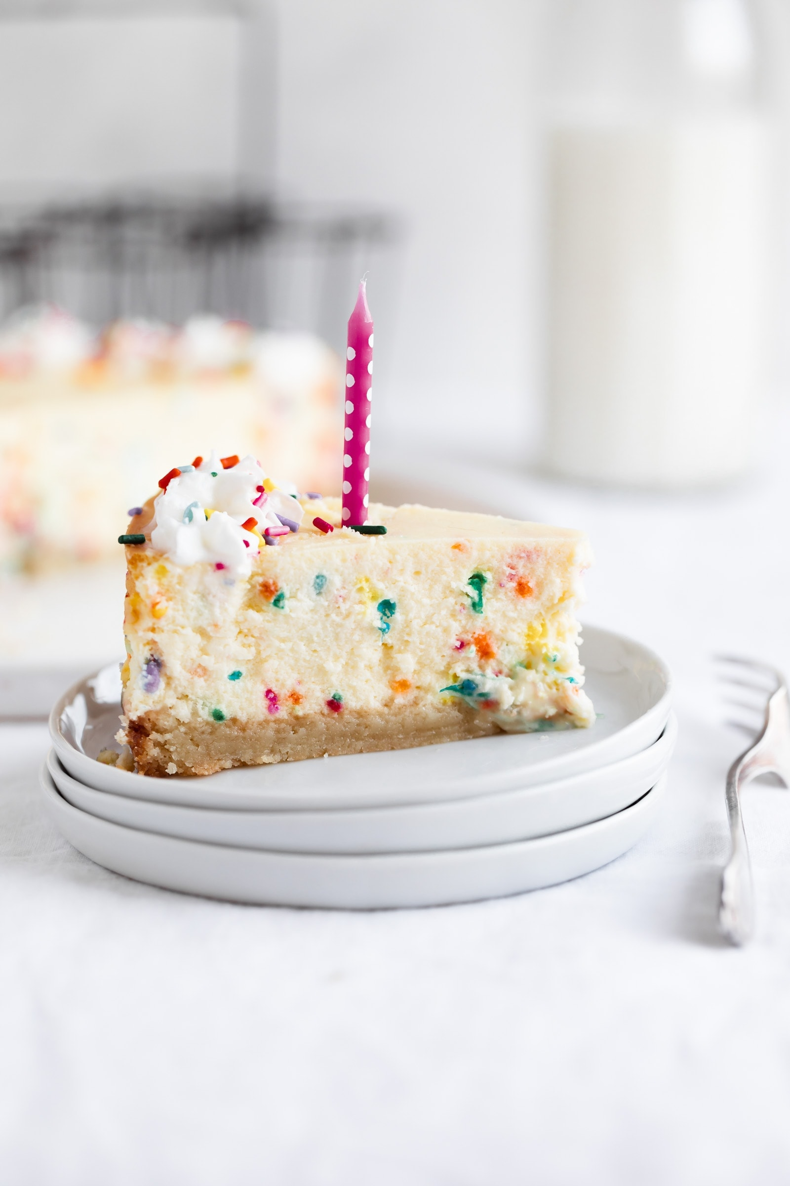 slice of easy birthday cheesecake with candle