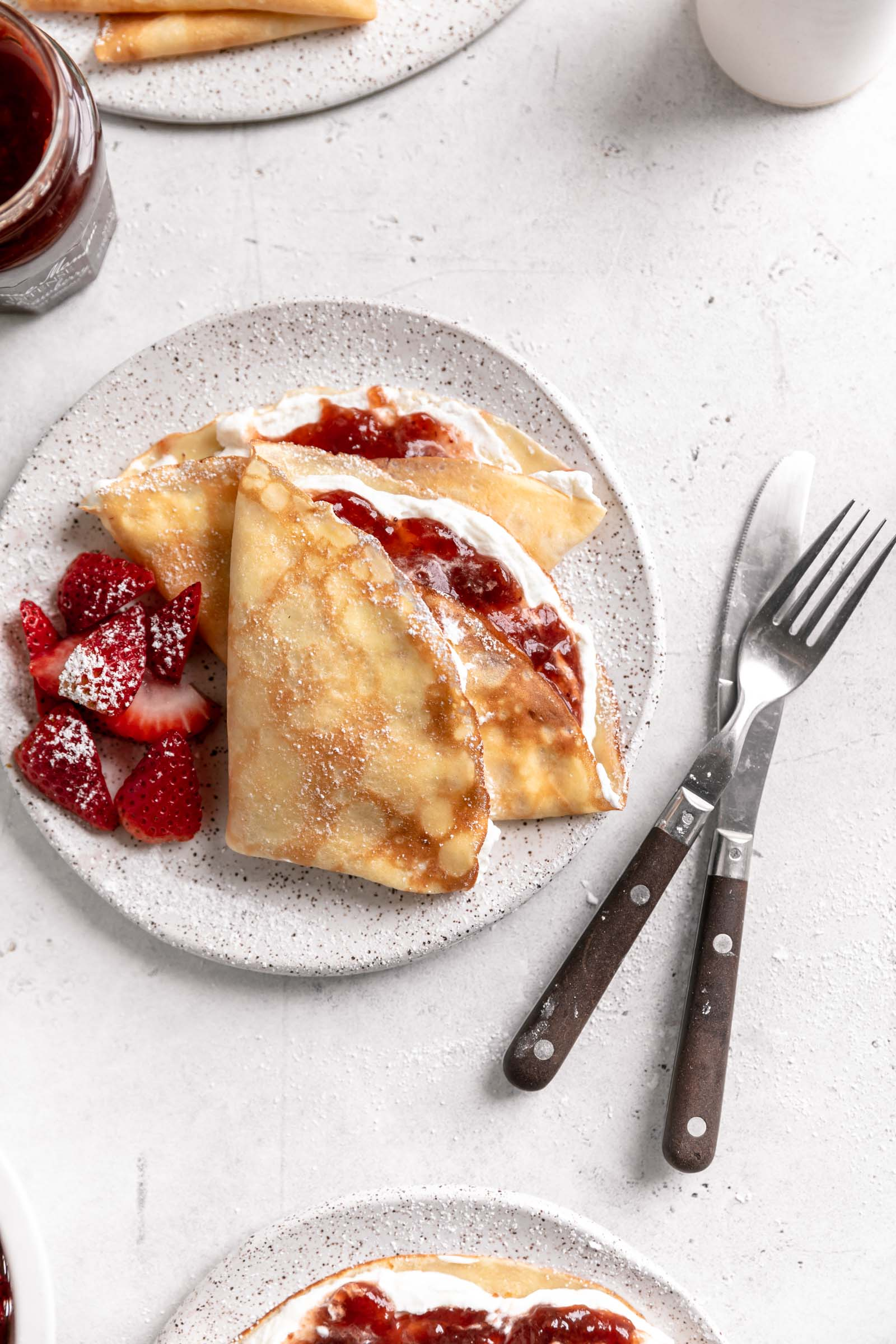 strawberry crepes with whipped cream and strawberry jam