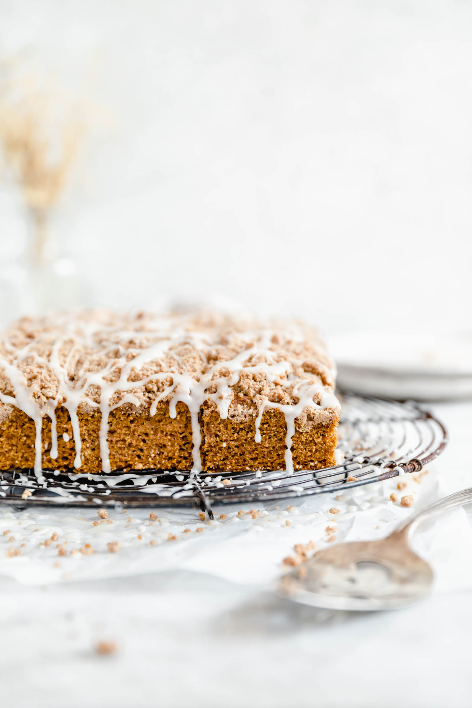 pumpkin coffee cake with crumble topping and cinnamon cream cheese glaze