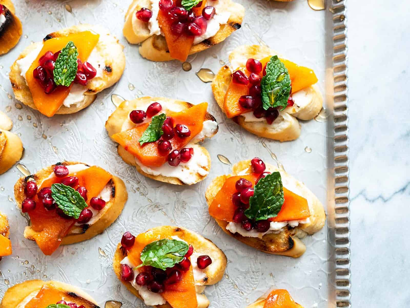 These Pomegranate Persimmon Crostini are as delicious as they are gorgeous. Plus, VERY easy-to-make! #vegan #soyfree #appetizer #veganyackattack
