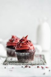 chocolate cupcakes for two topped with pink raspberry frosting
