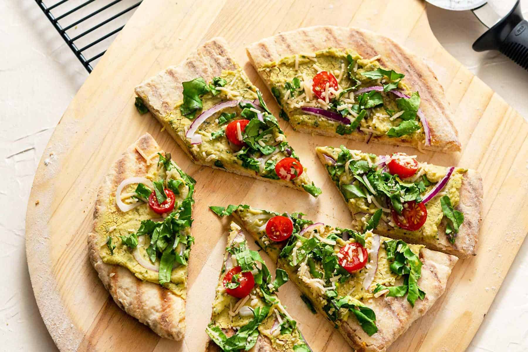 Grilled Sourdough Flatbread cut into slices on a wooden pizza peel