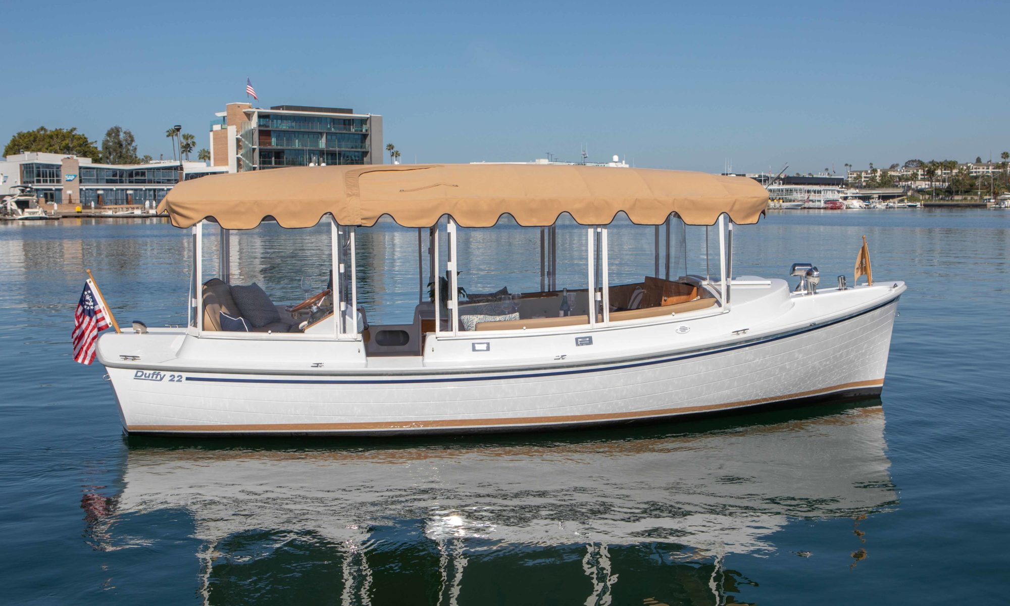 Image showing the 2020 Duffy Electric 22 foot Cuddy Cabin boat. Profile of the starboard side of the boat.