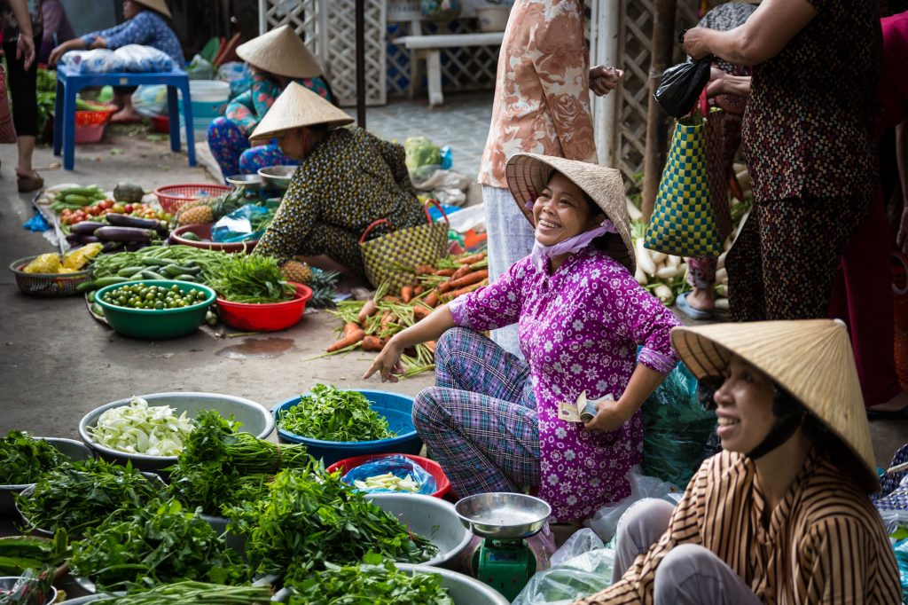 Woman selling at market for an article on the Cai Be Floating Markets