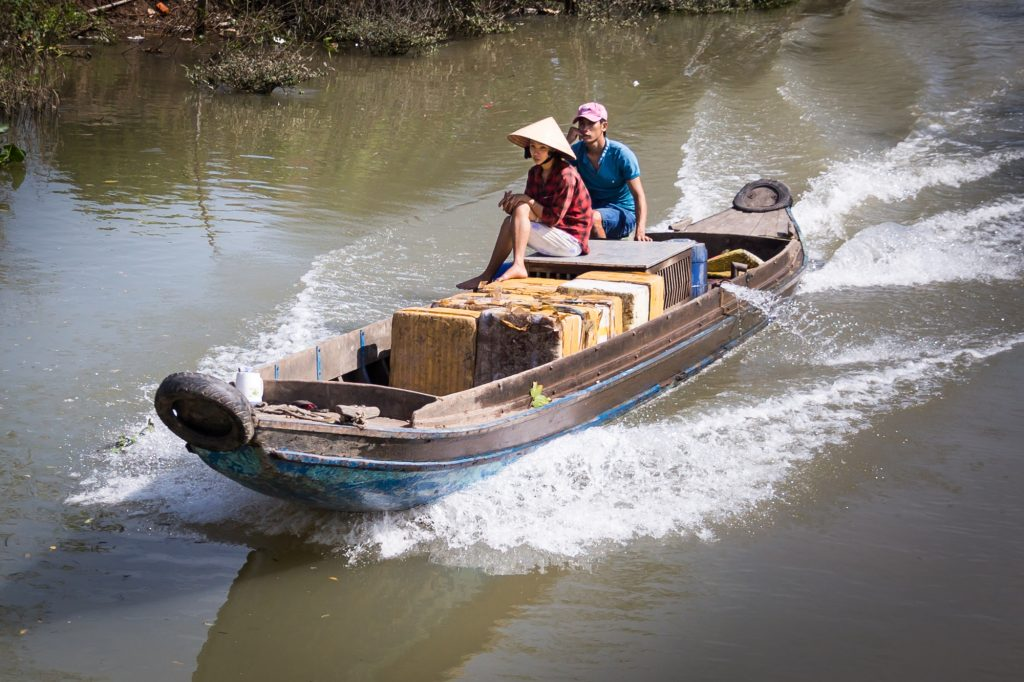 Boat on canal for an article on the Cai Be Floating Markets