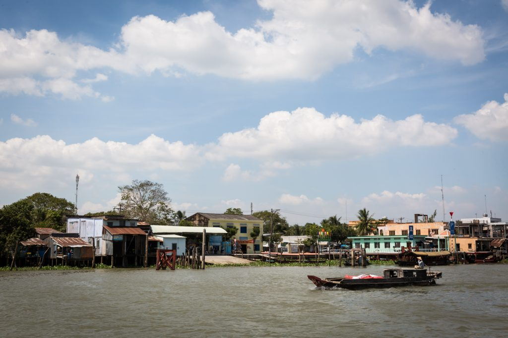 Boats on water for an article on the Cai Be Floating Markets