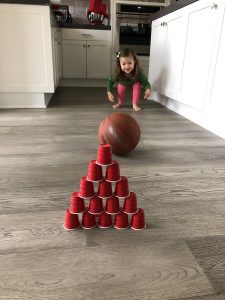 roll bowling ball to plastic cups