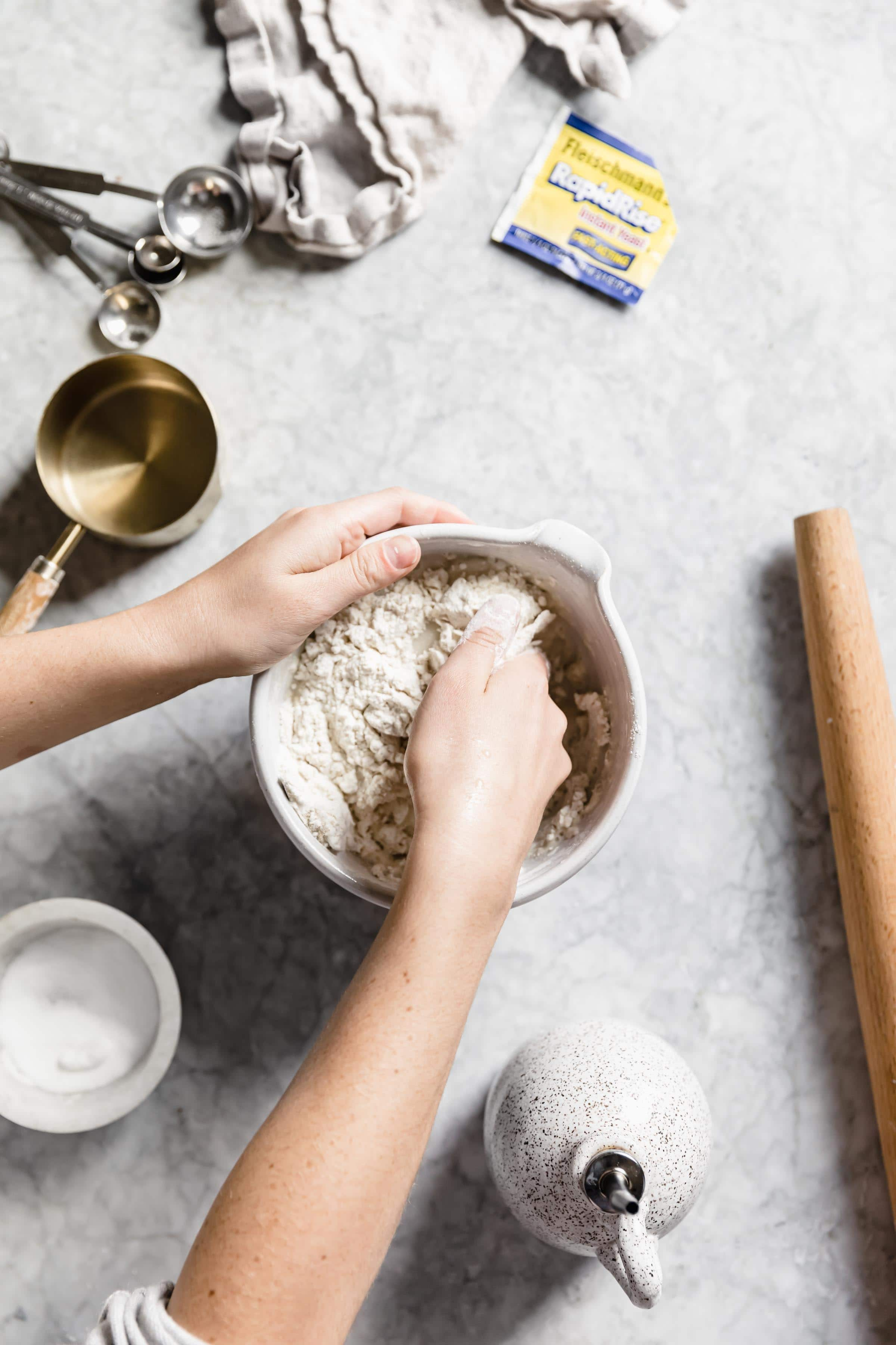how to make homemade pizza dough mix together with hands