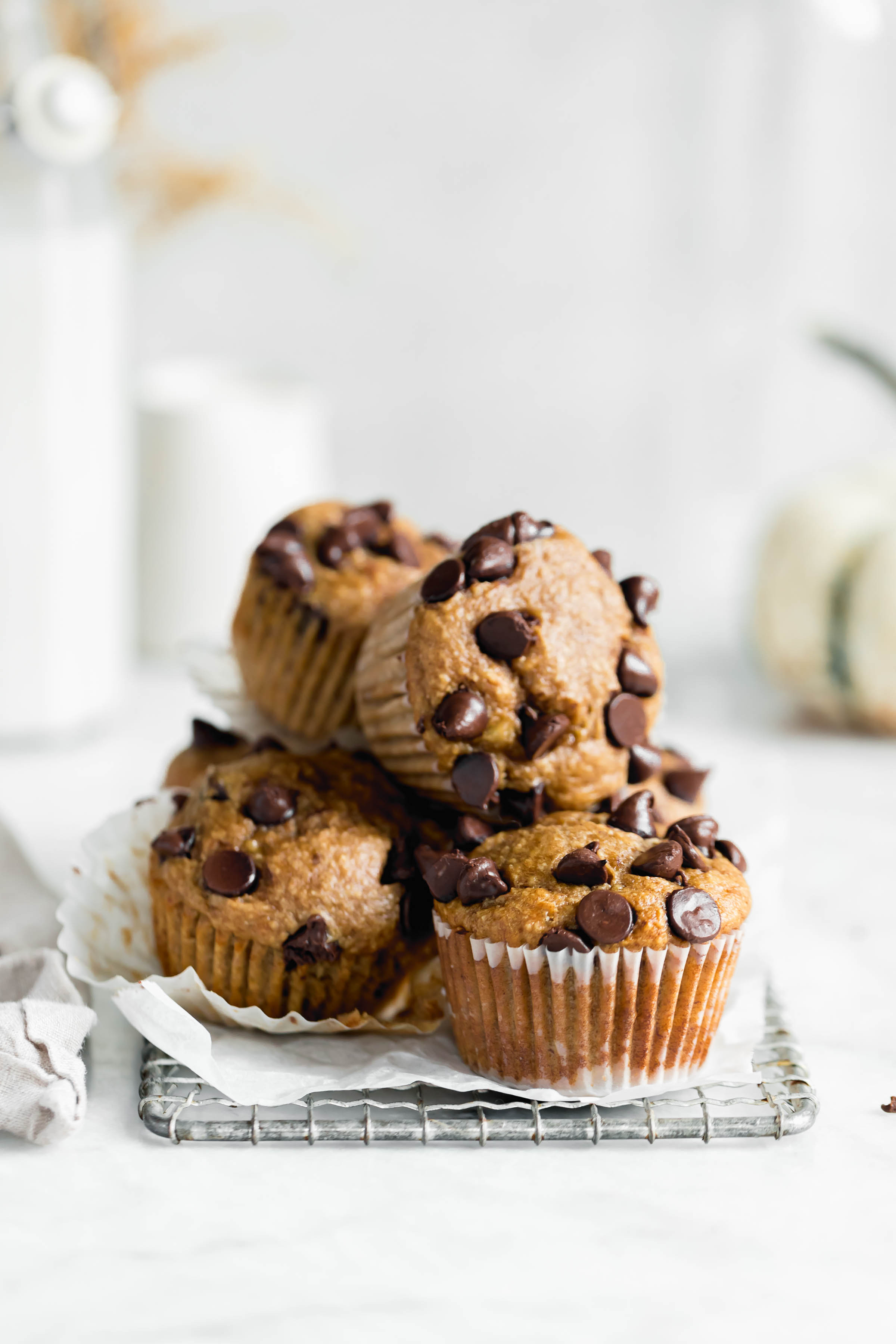 stack of healthy peanut butter banana muffins with chocolate chips