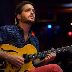 Photo of Yotam Silberstein & guitar