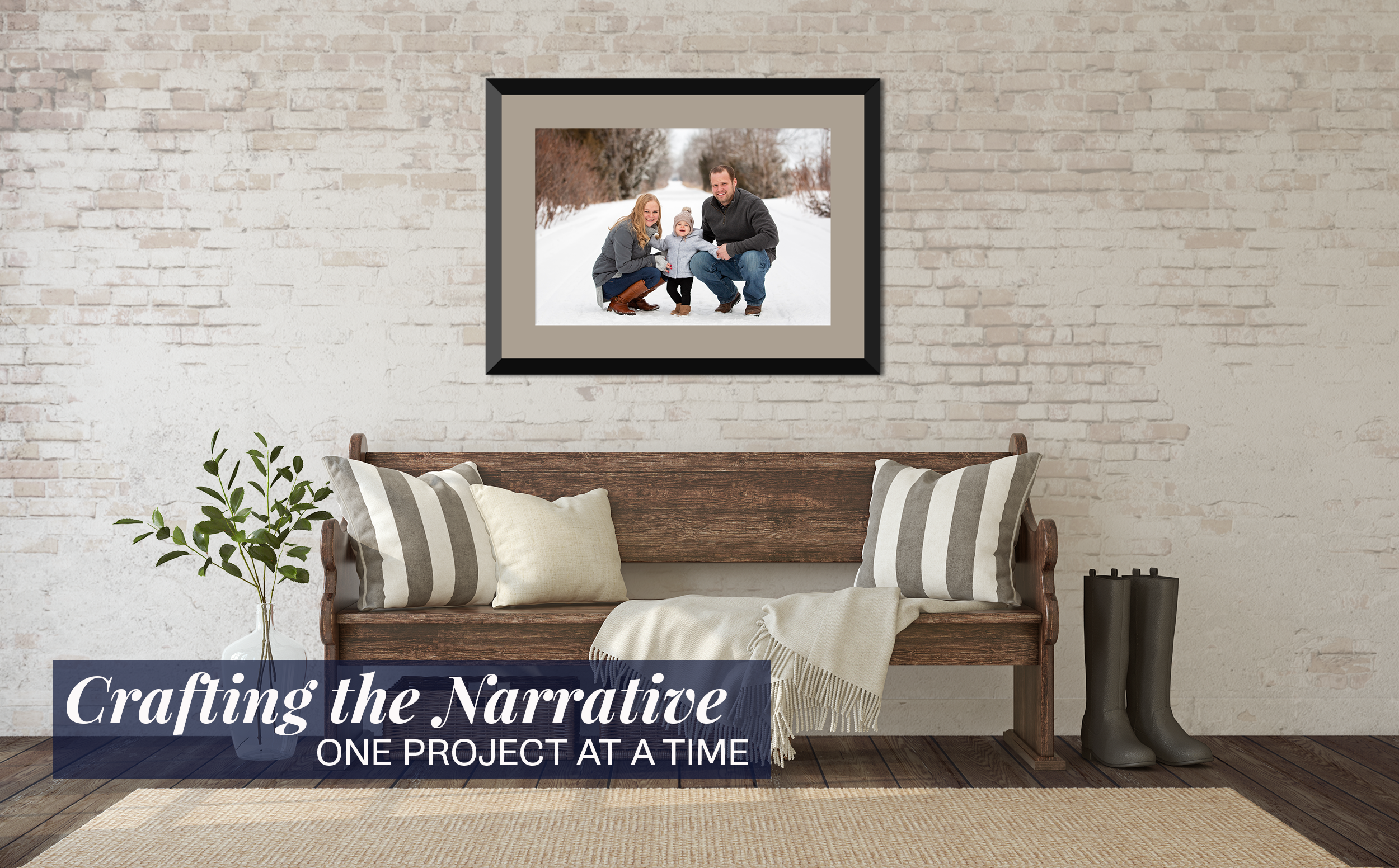 A brick entryway with a styled wooden bench. On the left is a plant, to the right sits a pair of rain boots. The focus of the image is a family photo of a young couple and their toddler in a winter setting.