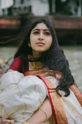 bengali girl in a traditional dress sitting on a boat