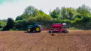 Green tractor drilling hemp seed for cbd wholesale