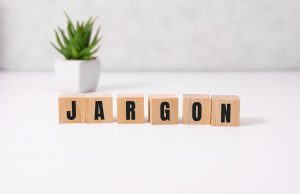 """Wooden blocks on a table spelling out the word """"jargon"""""""