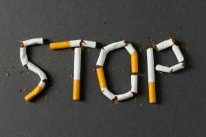 """Sign saying """"stop"""" made out of cigarettes"""