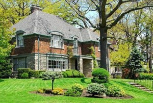 big brick house with nice green grass
