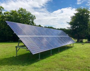 Solar-Panel-On-Large-Field-With-Trees