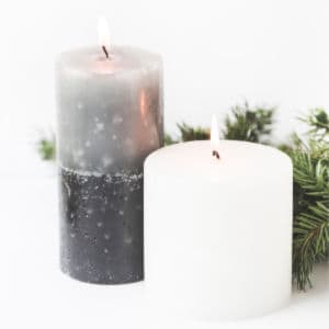 lighted candles and holiday greenery