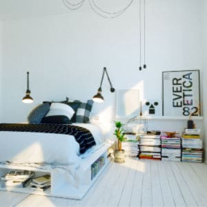 modern, organized bedroom with clean white walls