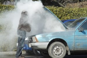 looking at a smoking engine in his car