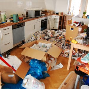 piles of clutter in a hoarder's house