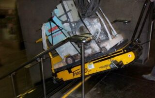 A Track O-75 stair lifted big heavy machinery inside a building