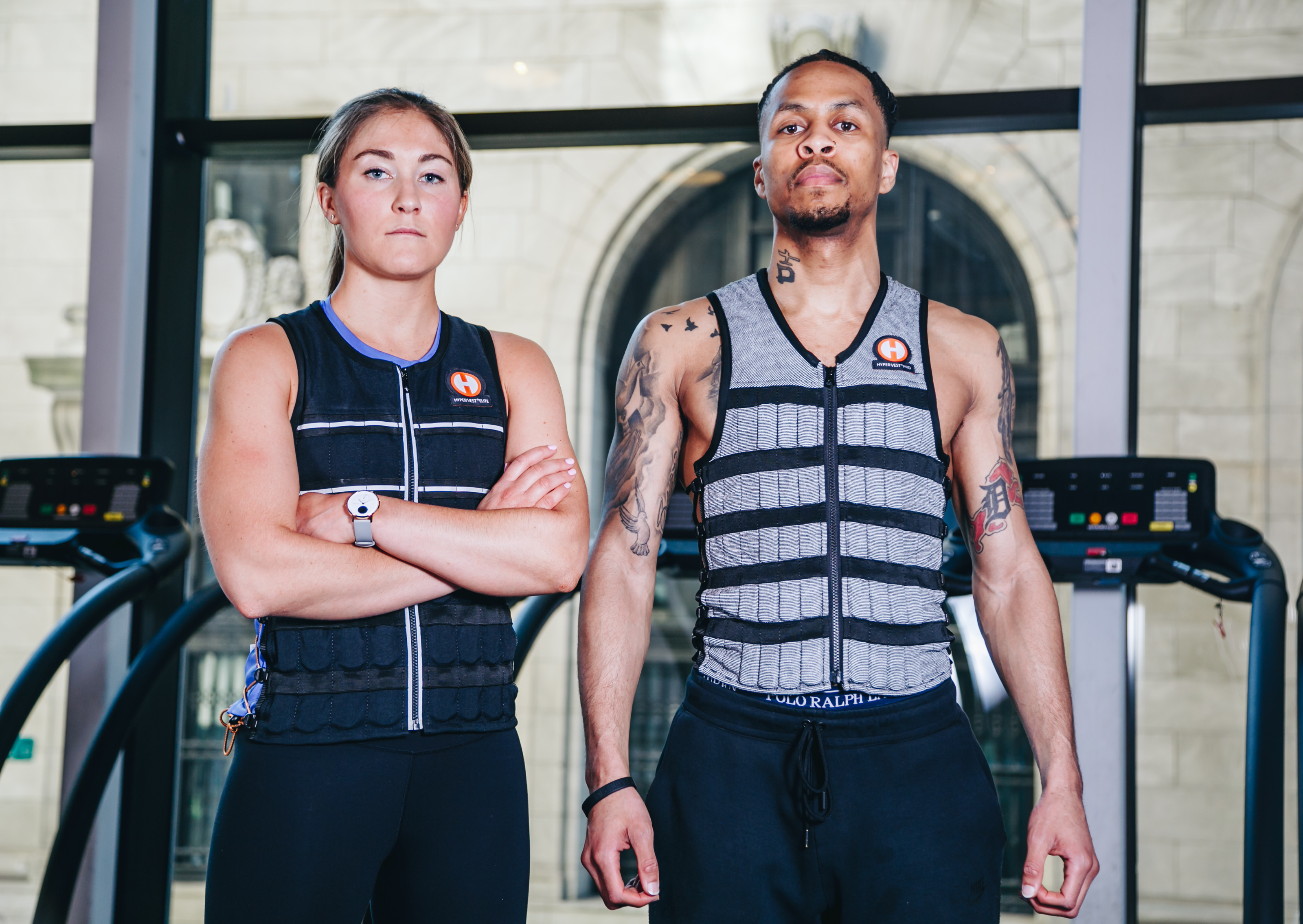 pair wearing weight vests